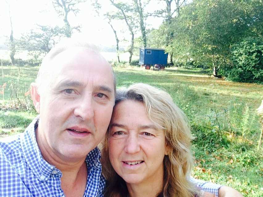 Tony and Jenny with the Shepherds Hut in the background