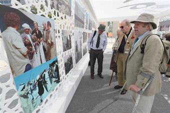 Robert Kenward and other veterans view their pictures from 1976