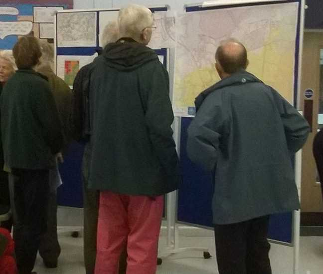 Studying maps at the Survey Review Information Evening in November 2014